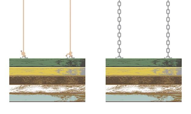 チェーンとロープにぶら下がっているヴィンテージの木の板