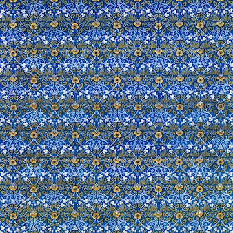Motivo floreale vintage giallo su sfondo blu