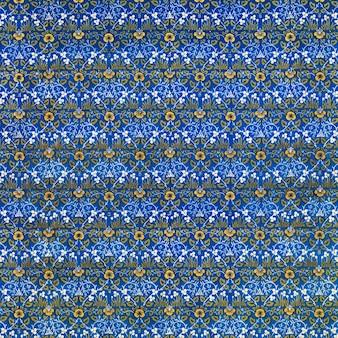 青い背景の上のヴィンテージ黄色の花柄