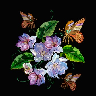 Violet flowers and butterfly, embroidery