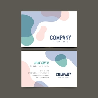 Visit company card with liquid coloured stains