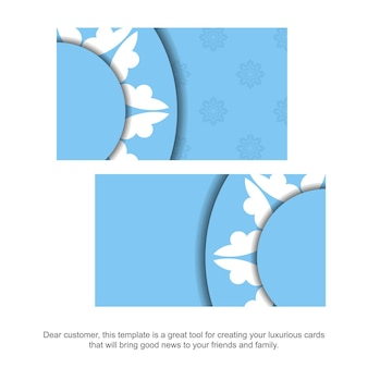 あなたのビジネスのためのヴィンテージの白い装飾が施された青い色の訪問名刺。