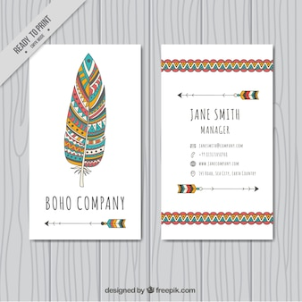 Визитная карточка с декоративными перо