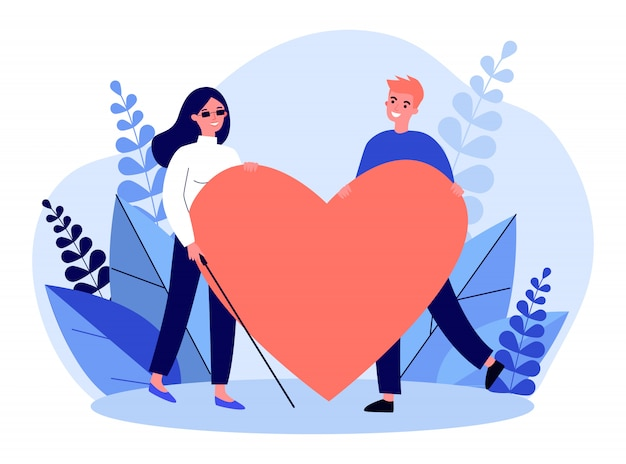 Visually impaired woman and man holding big heart