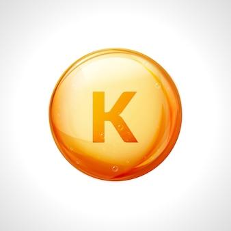 Витамин к оранжевый глянцевый диетический уход. здоровый органический символ витамин k питание диетическое.