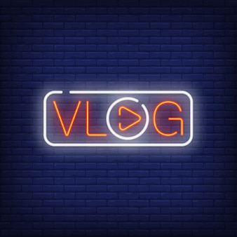 Vlog neon sign. bright text with letter o in shape of play button.