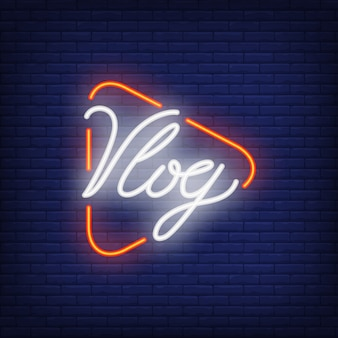 Vlog neon sign on brick wall. Bright lighting text on play button.