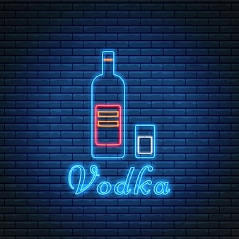 Vodka bottle and glass with lettering in neon style on brick wall