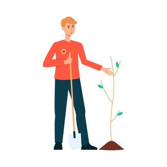 Волонтер сажает дерево на природе.