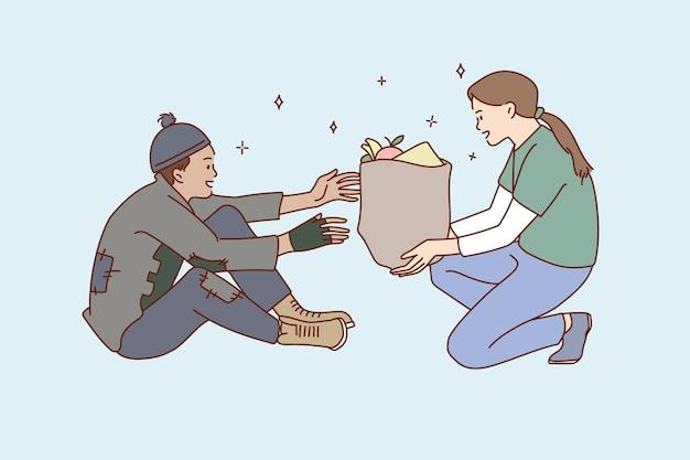자원 봉사자 여성이 노숙자에게 음식 기부 팩을 제공합니다.