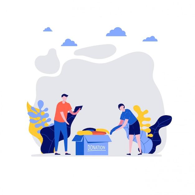 직장에서 자원 봉사자. 행복 한 젊은 커플, 남자와여자가 함께 옷을 기부. 자원 봉사 및 자선 사회의 개념.