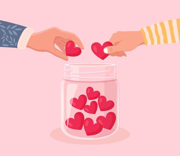 Добровольцы руки держат символ сердца и кладут сердца в стеклянную банку. дарите людям свою любовь, надежду и поддержку. благотворительность, пожертвования и щедрое социальное сообщество