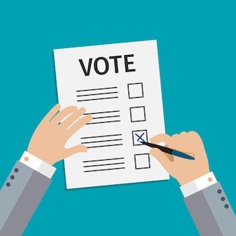 投票の概念。男は選挙に投票を書く