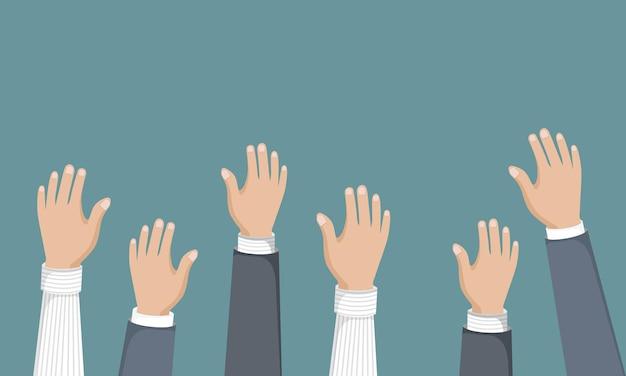 Voting or volunteering hands in the air