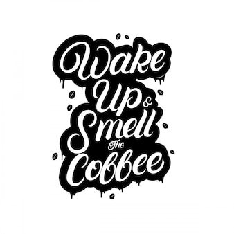 Wake up and smell the coffee hand written lettering with splashes.