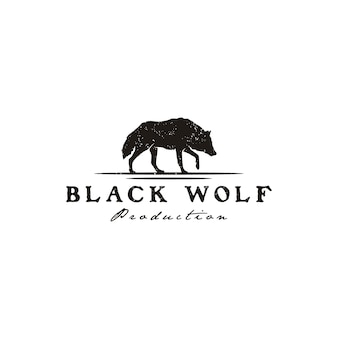 Walking black wolf fox dog coyote jackal rustic vintage silhouette retro hipster logo design