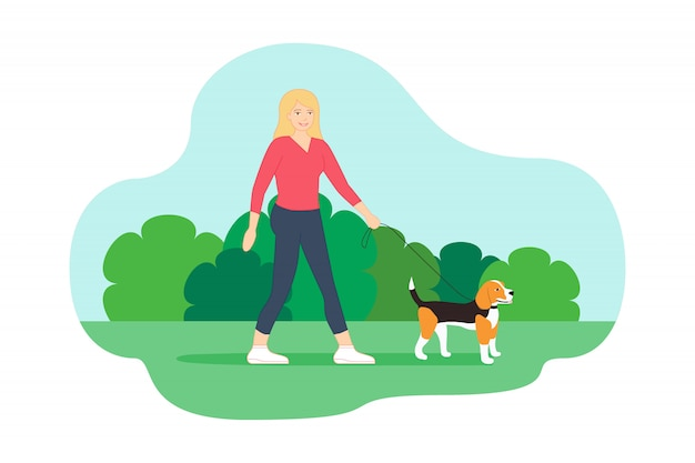 Walking in the park with her little beagle dog