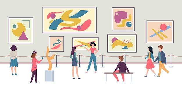 걷는 관광객과 미술품이 전시 된 패션 박람회
