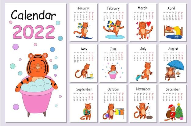 Шаблон оформления настенного календаря на 2022 год, год тигра по китайскому календарю на английском языке. неделя начинается в понедельник. векторная иллюстрация плоский с контуром.