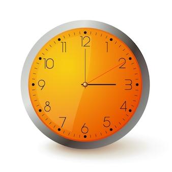 オレンジ色の文字盤と金属製の丸い壁時計