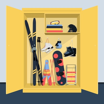 Wardrobe with equipment and clothing for winter sports.