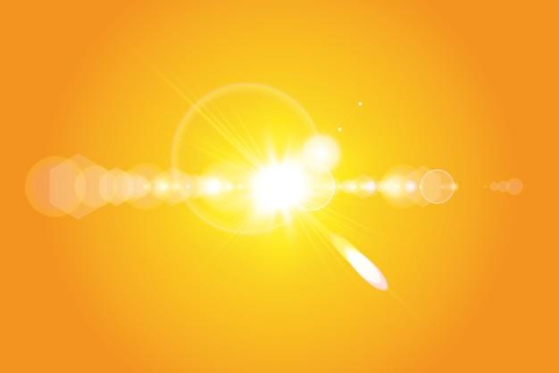 Теплое солнце на желтом фоне. лето. блики. солнечные лучи.