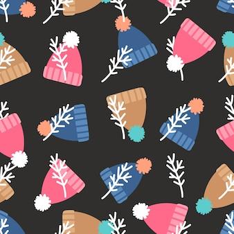 ポンポンのシームレスなパターンを持つ暖かい冬の帽子