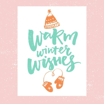 Warm winter wishes christmas card design vector typography with illustrations of hat and mittens