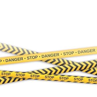白い背景の上の警告の黄色と黒のテープ。安全囲うリボン。図