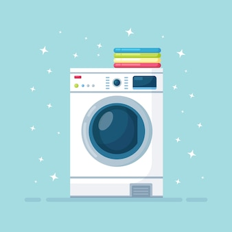 Washing machine  with stack of dry clothing. electronic laundry equipment for housekeeping