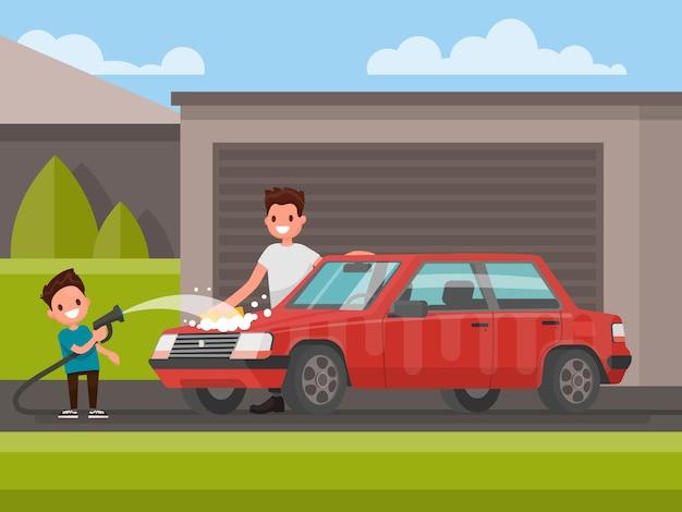 屋外の車の洗浄。父と息子は車を洗っています。図