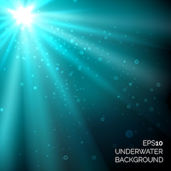 Under water blue deep ocean  background with bubbles. sunshine rays in water sea