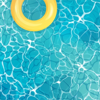 Water top view with yellow swim ring.