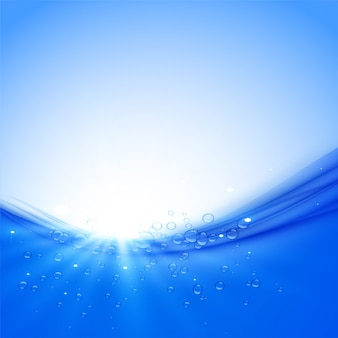 Water wave and bubbles with sun rays background