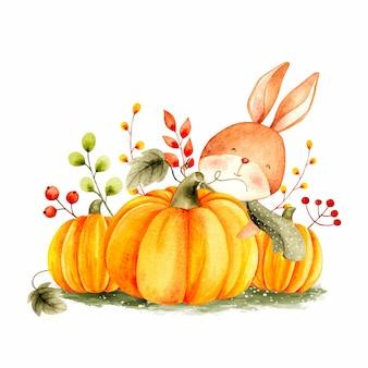 水彩の秋のウサギとカボチャ