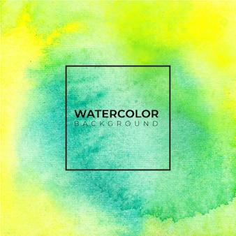 水彩画の背景。緑と黄色。白い紙の上にはねかける色