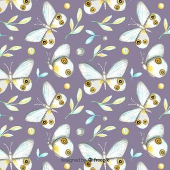Sfondo di farfalle e foglie ad acquerelli