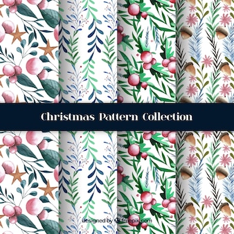 Watercolor christmas patterns with natural elements Premium Vector