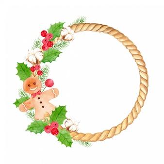 Акварельный рождественский венок с имбирным печеньем, хлопковым цветком, листьями падуба и сосны