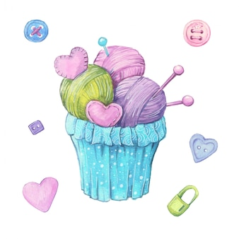 Watercolor cupcake made from balls of yarn and knitting needles