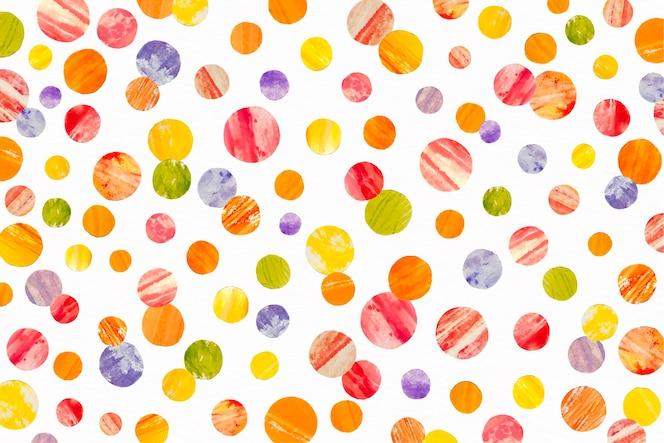 温かみのある色の水彩ドッティパターン