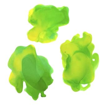 水彩の緑と黄色のスプラッシュセット。アルコールインクのテクスチャ。抽象的なカラフルな背景。手描きの水彩テクスチャ