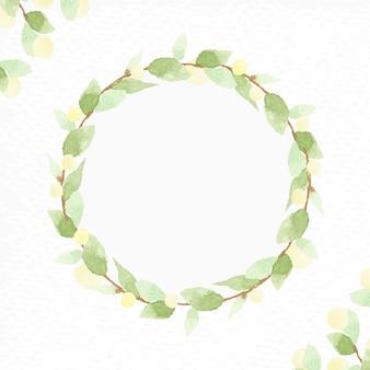 Акварельный венок из зеленых листьев с желтой лампочкой на рождество