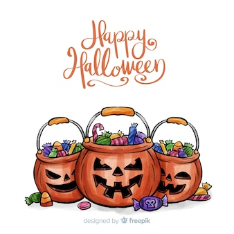 Watercolor halloween background with pumpkins and candies