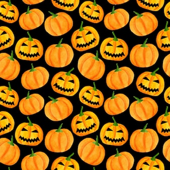 Watercolor halloween pattern with carved pumpkins
