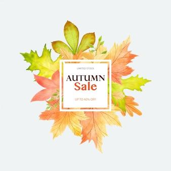水彩の手が秋の葉のフレームを描いた
