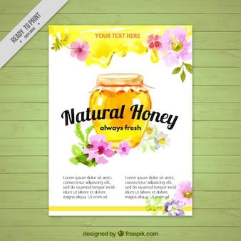 花のパンフレットと水彩蜂蜜の瓶