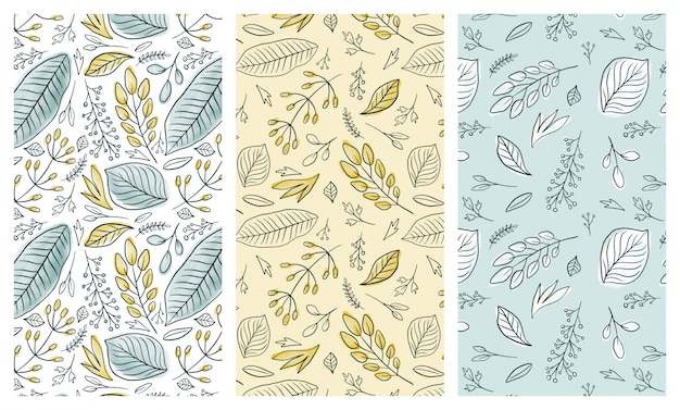 Watercolor inky leaves seamless patterns set