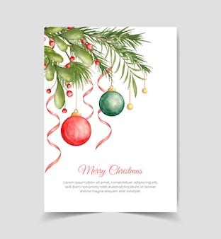 Акварельная поздравительная открытка с рождеством с ветвями сосны и елочным шаром