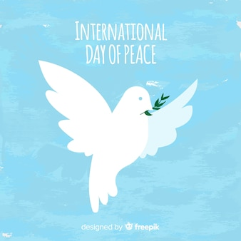 Watercolor peace day background with white dove